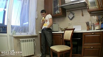 Cute boy ge naughty with a banana in the kitchen